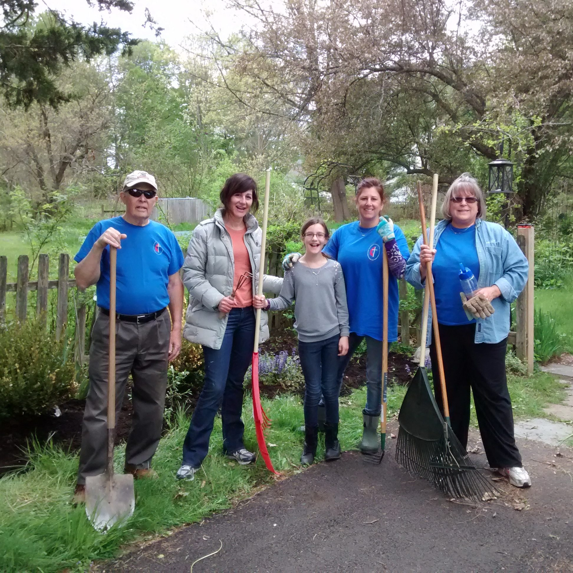 Church members with rakes and shovels