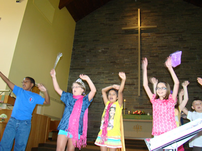 Children dancing and waving their arms