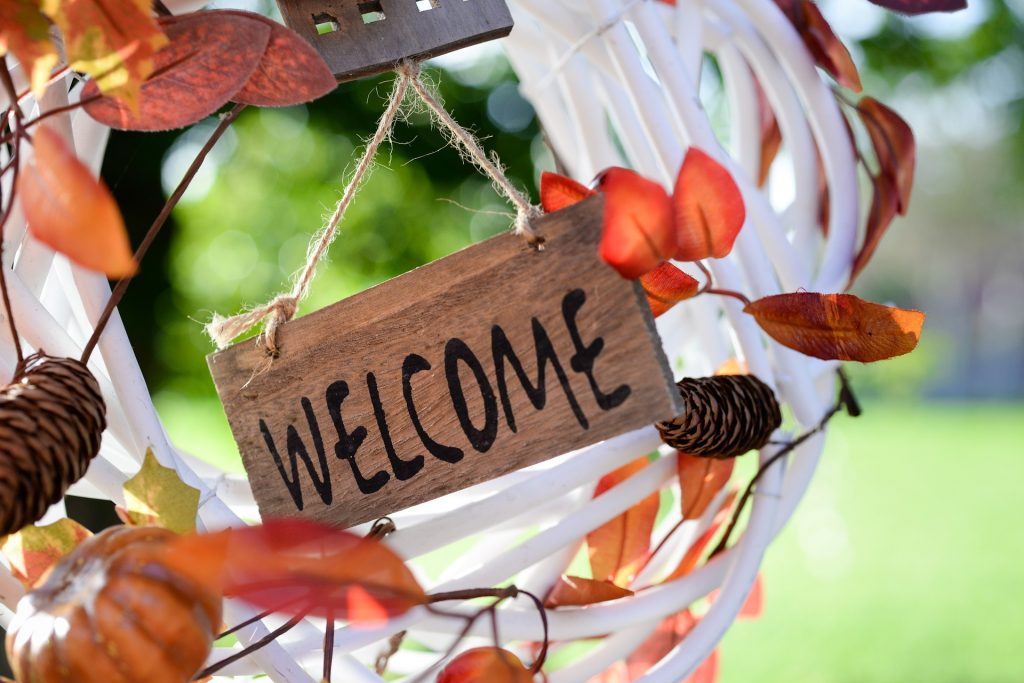 Welcome sign on a white grapevine wreath