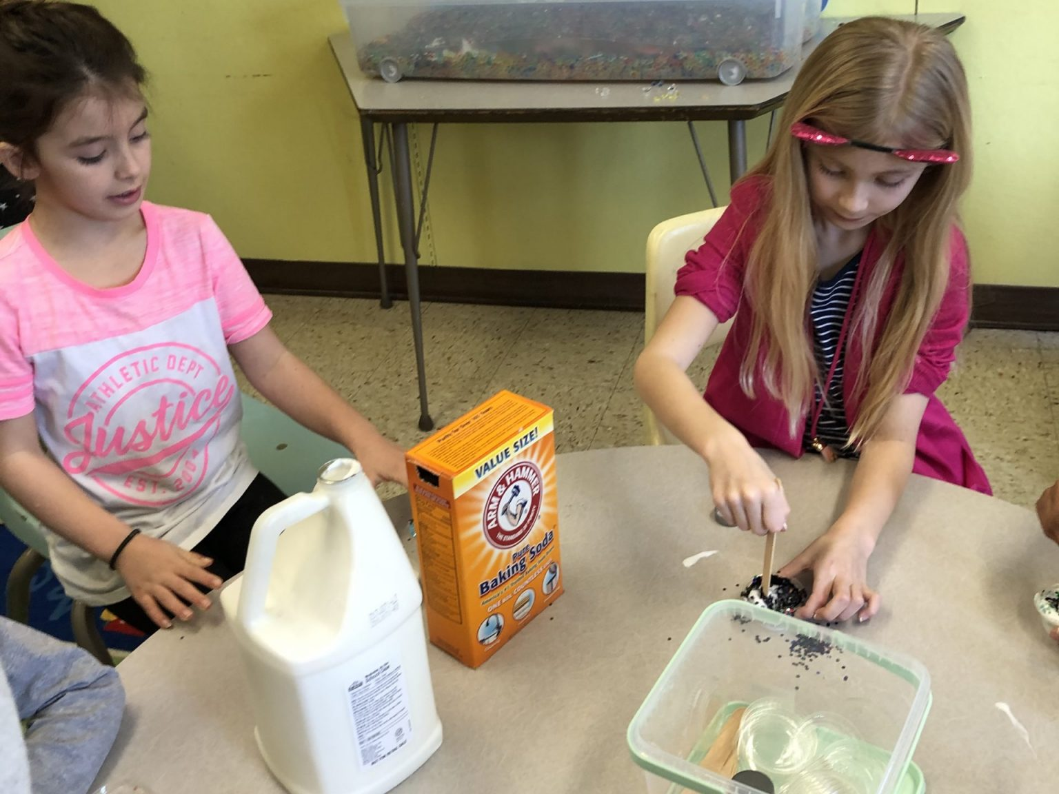 Two girls doing a craft project