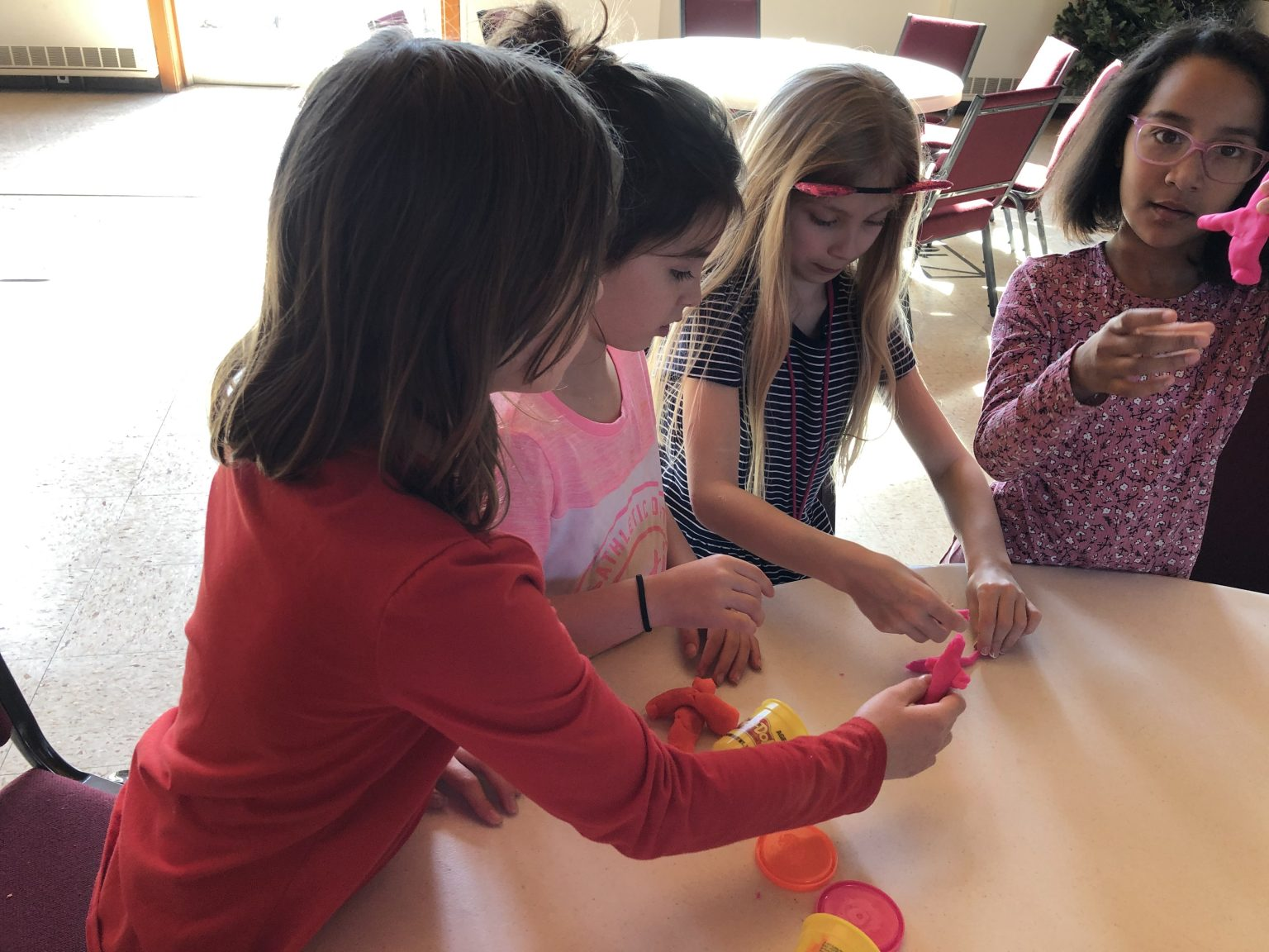 Four girls playing with Playdough