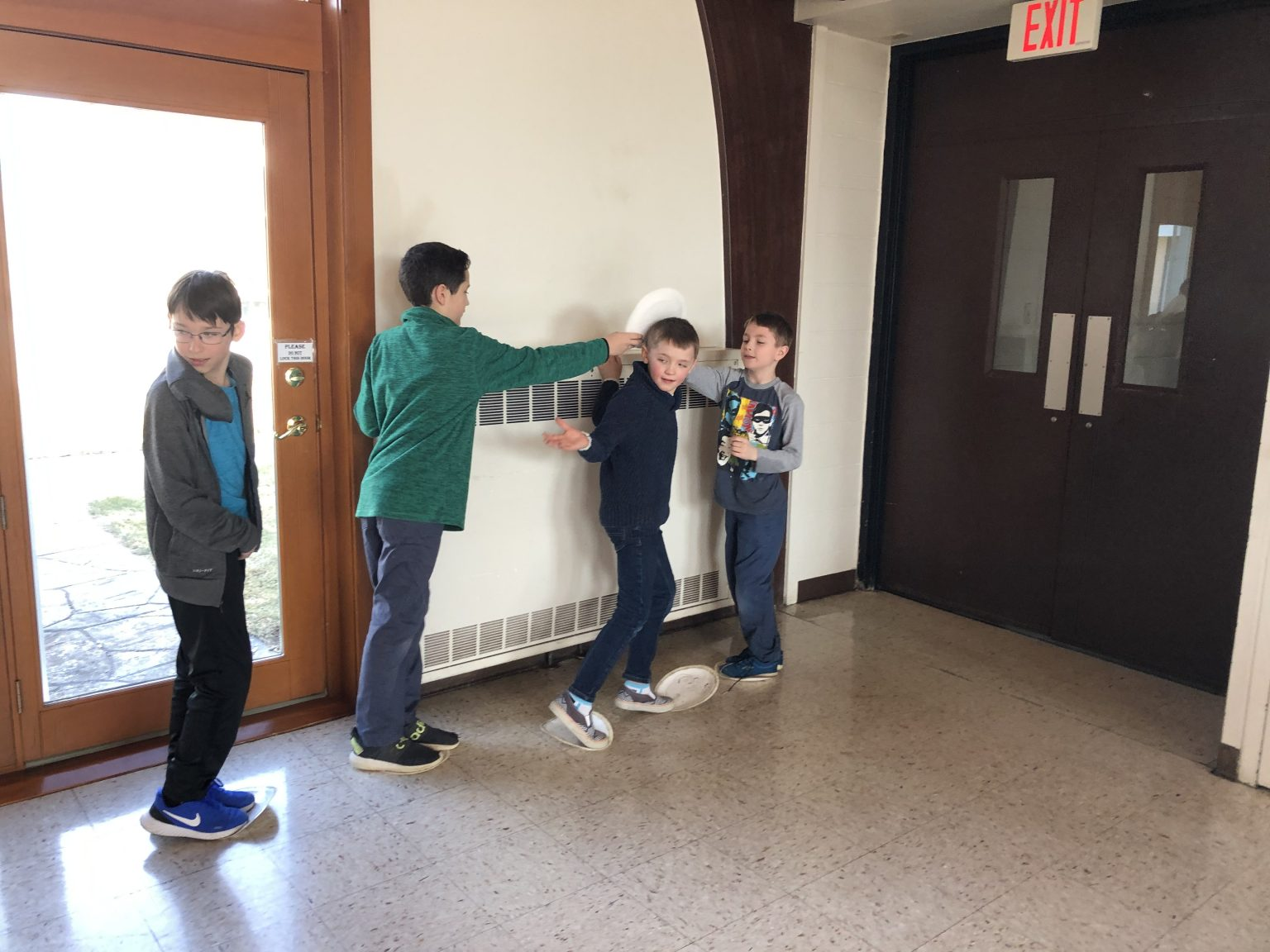 Four boys playing a game