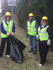Kate Henson, Keven and Cindy Conley picking up garbage along Columbia Turnpike